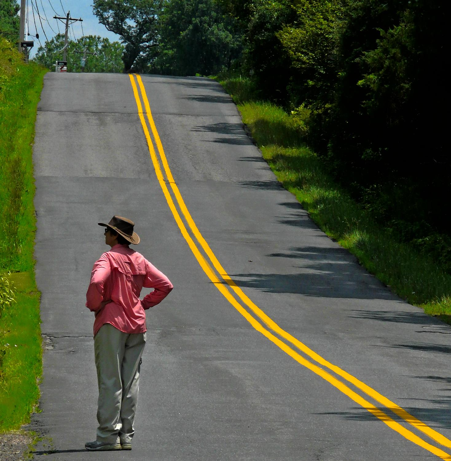 the artist's muse by a hilly road with a yellow stripe - The artist's muse contemplates the next hill on the way home. - Panasonic DMC-FZ18 - Tony Karp, design, art, photography, techno-impressionist, techno-impressionism, aerial photography , drone , drones , dji , mavic pro , video , 3D printing - Books -