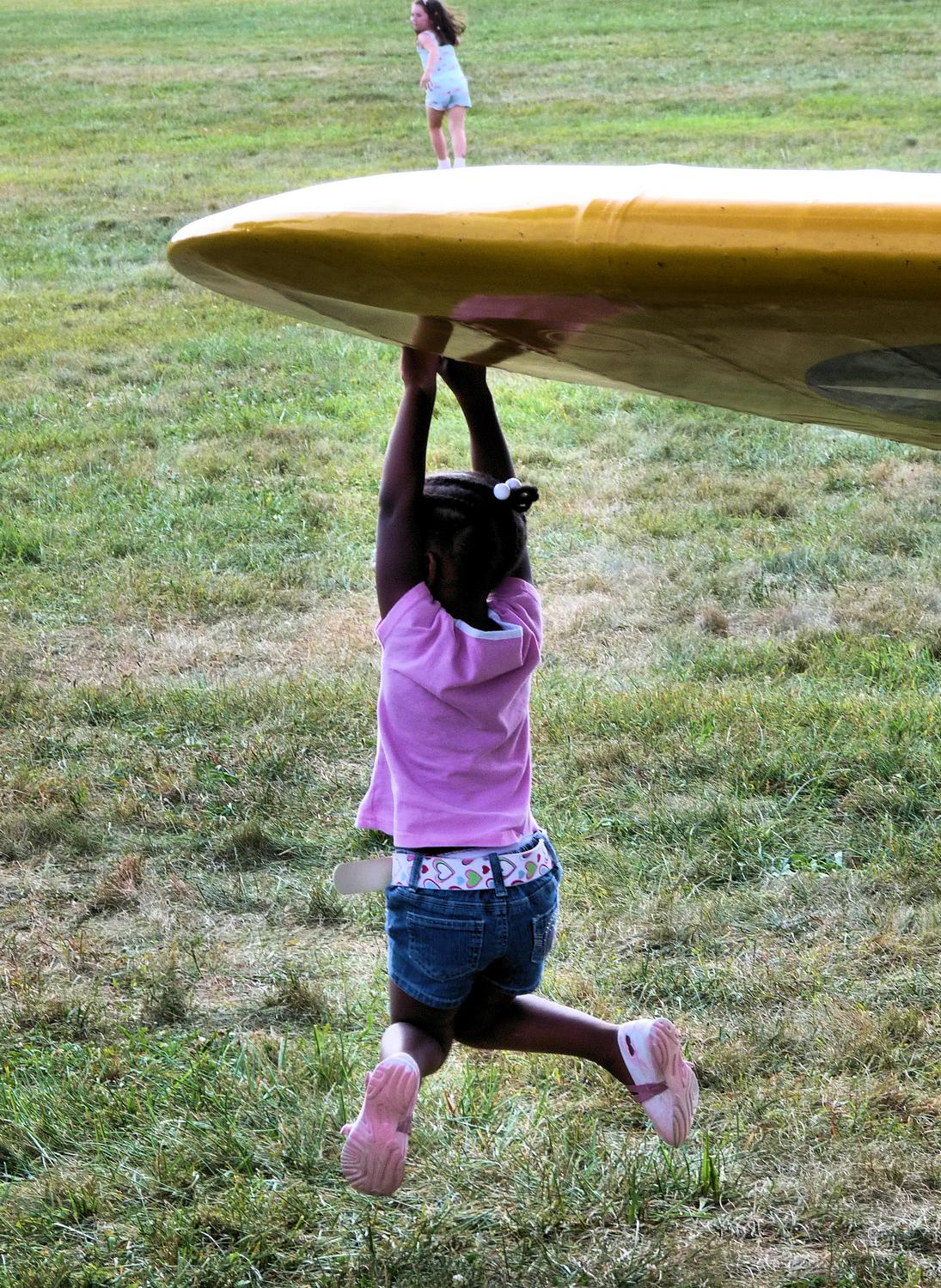 girl hanging from airplane wing - A future wing walker hones her skills. - Panasonic DMC-FZ28 -- At the Flying Circus - Bealton Virginia - Tony Karp, design, art, photography, techno-impressionist, techno-impressionism, aerial photography , drone , drones , dji , mavic pro , video , 3D printing - Books -